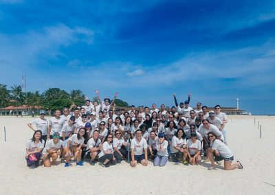 InCorp group photo at the beach